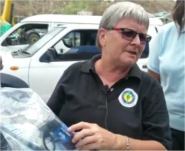Jenny Tryhane the Founder of United Caribbean Trust distributing Sawyer PointOne Filter in Dominica llowing the hurricane Maria in 2017